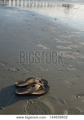 Sandals on the beach during the morning