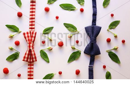 Colorful pattern made of berries, leaves and bow ties