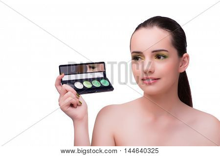 Young woman during make-up session isolated on white