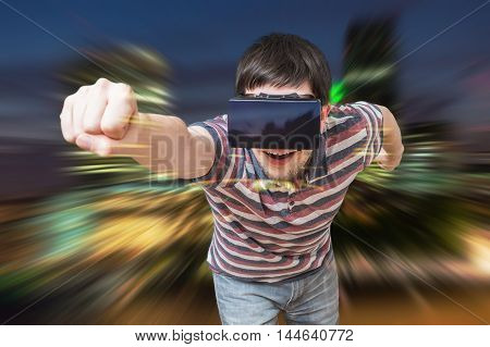 Young man is in 3D simulation of city. He is wearing virtual reality headset.
