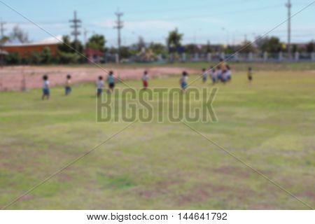 Blur blurred  Student Kindergarten. running on grass in school Teachers have run lead.