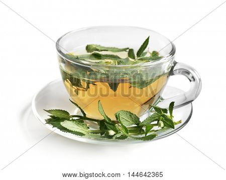 Cup of sage tea isolated on white