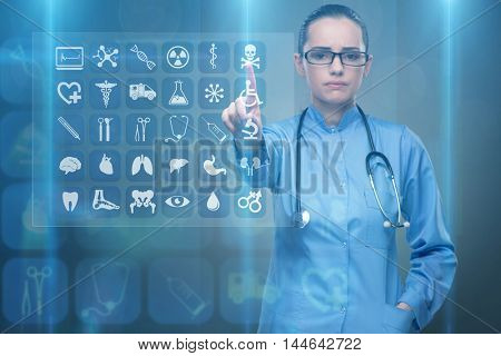 Woman doctor pressing buttons with various medical icons
