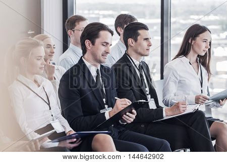 Business group of people making notes during a meeting conference