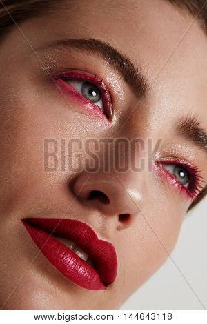Woman With A Drama Red Makeup. Fashion Makeup