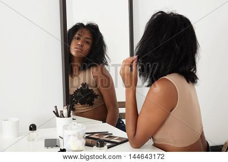 Woman Watching In Mirror Making Daily Routine