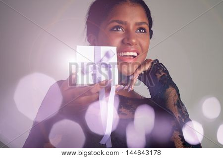 Happy Laughing Woman With A Present Box In Hands And Bokeh