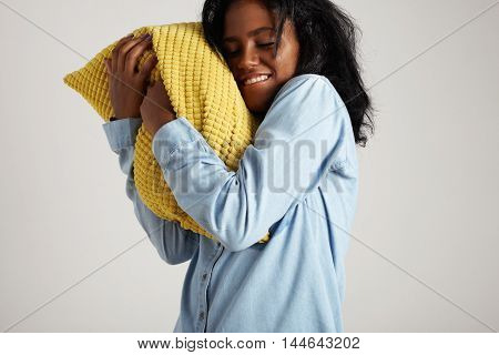 Black Woman Takes In Her Arms A Pillow. Dream Concept