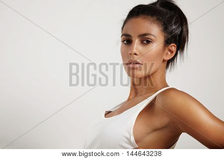 spanish woman with healthy shining skin in studio