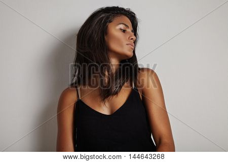 beauty spanish woman with long hair watching aside