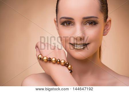 Nice woman wearing elegant jewellery