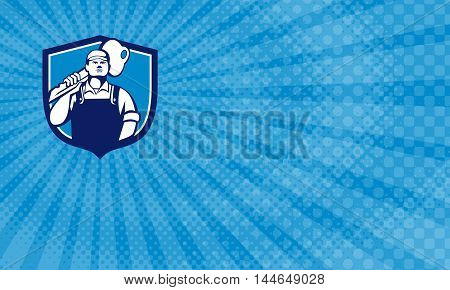 Business Card showing Illustration of a locksmith standing facing front carrying key on shoulder set inside shield crest on isolated background done in retro style.