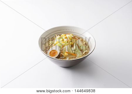 Japanese Koishiwara grilled ramen bowl with egg cabbage noodle and corn on white background