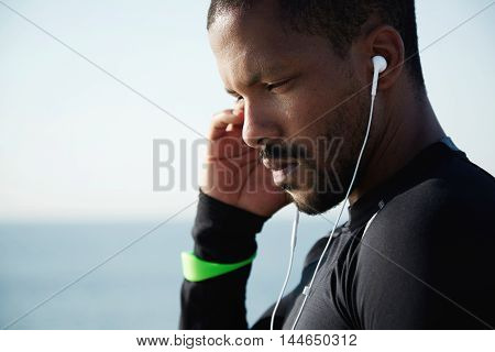 People And Sport Concept. Attractive Young Athlete In Sportswear Listening To His Favourite Tracks I
