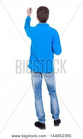 back view of writing business man. Curly boy in the blue jacket writes on the blackboard.