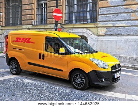 BUDAPEST HUNGARY - MAY 20: Yellow DHL van parked in the street of Budapest city on May 20 2016. DHL Express is a division of the German worldwide logistics company.