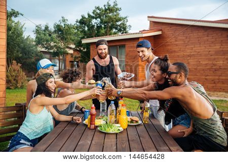 Group of happy young people celebrating and having outdoor party