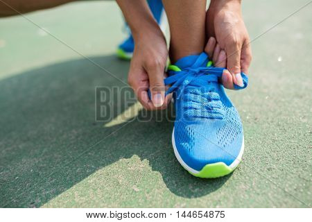 Woman trying the shoelace