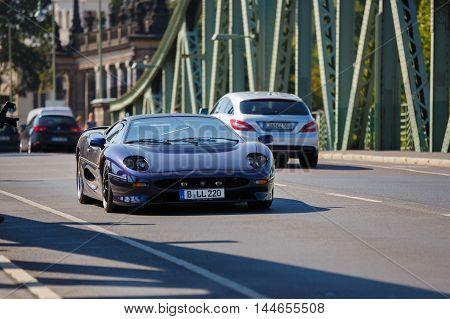 Potsdam Germany - August 27 2016: Sportcar Ferrari goes on a Glienicke Bridge in open motor Rally Hamburg-Berlin Klassik the date of August 25-27