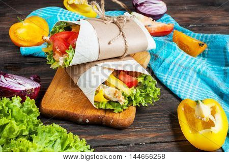 Burrito with grilled chicken and vegetables - pita bread, shawarma.