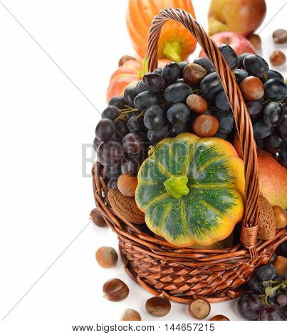 Autumn harvest in a basket on a white background