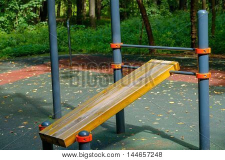 Public training ground in a park at summer