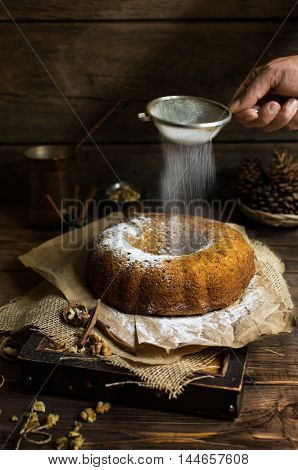 Parsnip and carrot bundt cake with powdered sugar