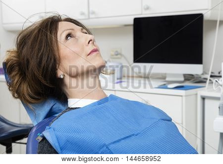 Patient Sitting At Dentist's Clinic