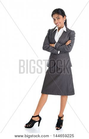 Full length portrait of African American businesswoman standing arms crossed isolated on white background.