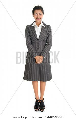 Full length portrait of Indian businesswoman standing isolated on white background. Mixed race Asian Indian and African American model.