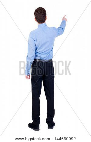 Back view of pointing business man. Businessman in a blue shirt pointing her finger away.