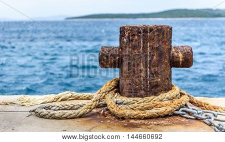 Old Rusty Steel Mooring Bollard Pole On A Pier.