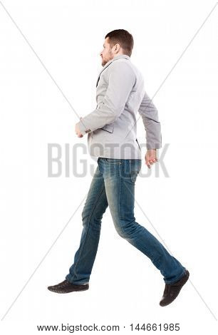 Back view of running business man. man in a gray jacket moves with great leaps.