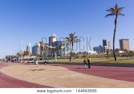 People Enjoy Early Morning Walk Along Promenade In Durban
