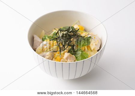 Curry ramen bowl with seaweed pork egg cabbage and herbs on white background