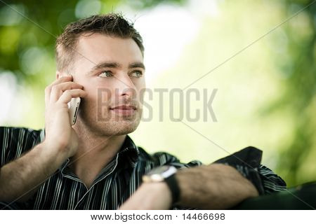 Caucasian man with cell phone in nature