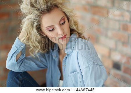 Lovely girl with curly hairstyle