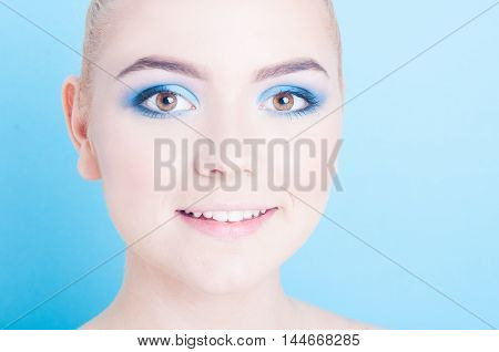 Close-up Of Girl Posing With Professional Colored Make-up