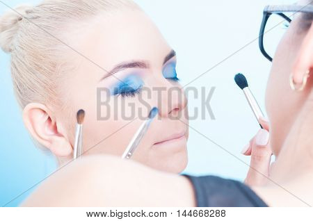 Applying Professional Colored Make-up On Beautiful Girl