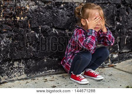 Little Beautiful Girl Near Brick Wall