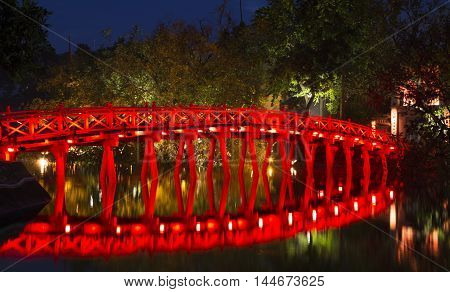Hoan Kiem (Sword) lake at night with old red The Huc wooden bridge