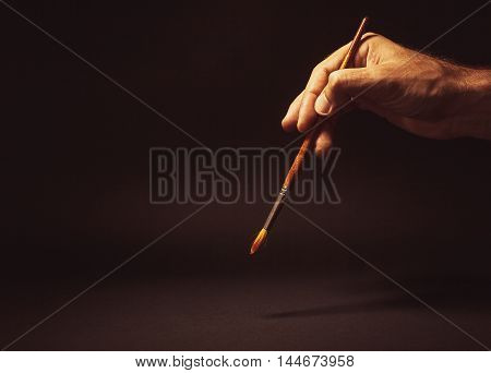 Male Hand Holding A Brush