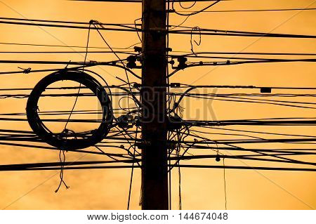 Silhouette Wires on electric poles at busy in evening time