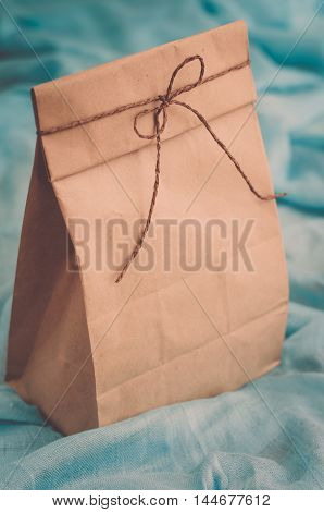 Gift package of kraft paper tied with a rope (vintage)