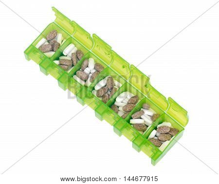 Green weekly pill organizer separated on white background