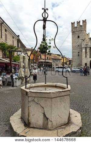 SIRMIONE ITALY - MAY 5 2016: Piazza Catello in Sirmione Lake Garda Italy