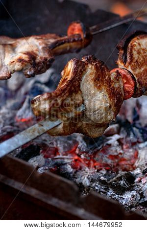 skewers fire-roasted meat with tomatoes embers and smoke