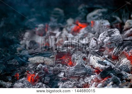 embers for cooking kebabs with ash and little lights