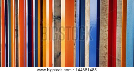 Colorful Fence. Repeated Wooden Blocks. Aged Photo