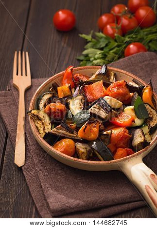Grilled vegetables on serving pan on table